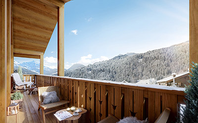 3D graphics of a chalet balcony with mountain view